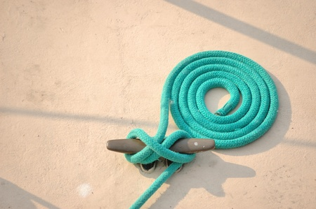 A corded up ship rope at a dock. Stok Fotoğraf