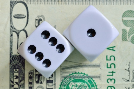fifty dollar bill: Closeup of a pair of dice with seven showing on a fifty dollar bill. Stock Photo
