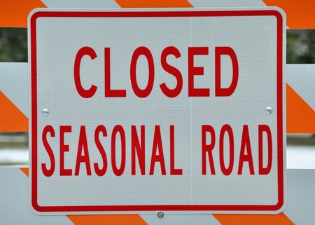 stating: Seasonal Road Sign stating that the road is closed.