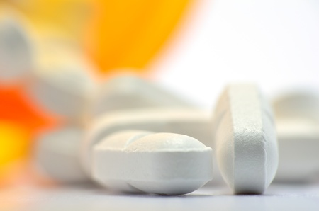 A bottle of pills macro for background or copy space. Stock Photo