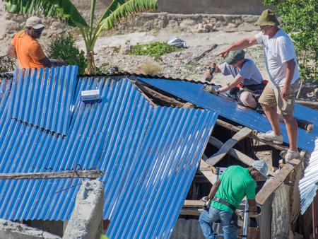 Men working on Village of Bonbon Haiti homes after hurricane Matthew destroyed it in October 2016. 新闻类图片