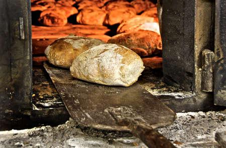fire brick: Fresh bread made in a brick oven Stock Photo