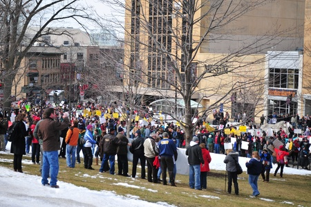 bill of rights: Madison, Wisconsin, USA – 2-15-11 –Throngs of protesters on grounds of the Wisconsin state capital who are there to protest the bill to balance the state budget by restricting collective bargaining rights for state union employees.