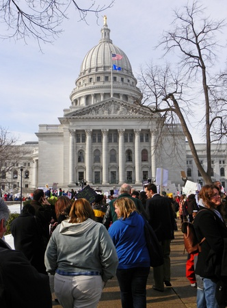 Madison, Wisconsin, USA – 2-16-11 – Crowd of protesters in front of the Wisconsin state capital who are there to protest the bill to balance the state budget.