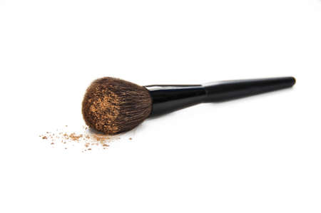 face powder: Cosmetic brush with make up isolated on white background