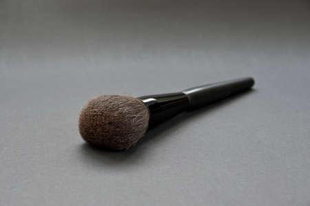 cosmetic brush on dark backgorud Stock Photo