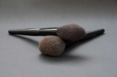 cosmetic brushes on dark background