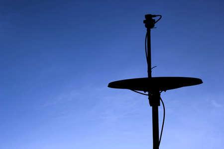 satellite dish on blue sky photo