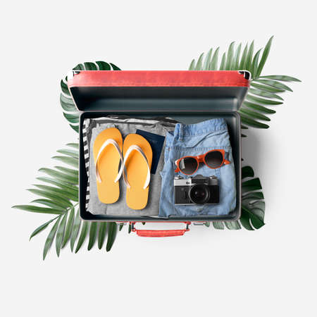 Travel bag with clothes Standard-Bild
