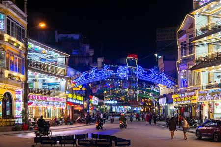 Sapa, Vietnam, Oct 09, 2018. Sapa city at night. Shop and restaurant along street in town at night.