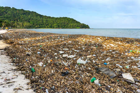 Environmental disaster. Garbage dump on Bai sao beach with white sand on the coastline. Plastic rubbish pollution in ocean.Plastic water bottles and bags thrown directly into the sea with no proper trash collection or recycling. Phu Quoc island, Vietnam Reklamní fotografie