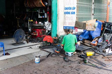 Loa Chai, Vietnam - Oct 11,2019. On the streets of Vietnam. Scene welder working