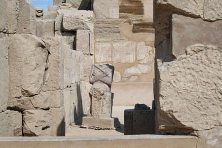 ruined headless statue in the guise of god Osiris in Karnak Temple Complex Stock fotó