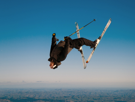 Guy on skis dowing a wicked back flip!! photo