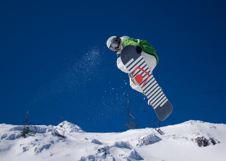 tweak: Person doing a 360 on their snowboard. Stock Photo