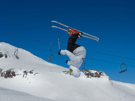 tweak: Person pulling a flip on their skis