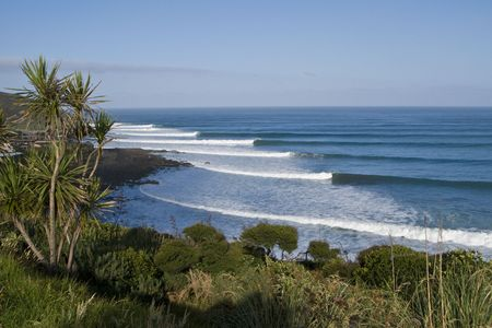 swell: Long lines of breaking waves
