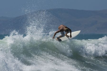 floater: Image of a surfer doing a Floater move over a breaking section of the wave.
