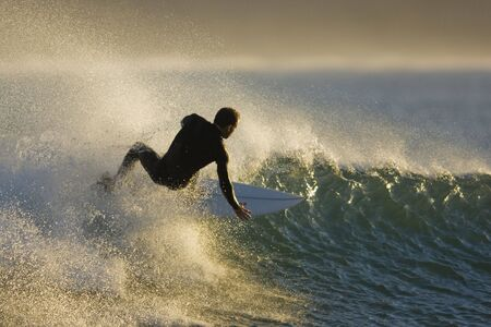 floater: Guy surfing down a wave