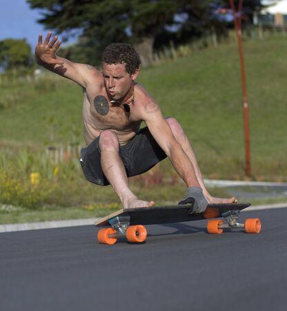 Guy riding old school Longboard photo