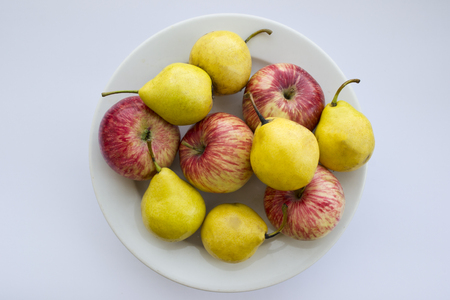 Plate of red apples and yellow pears