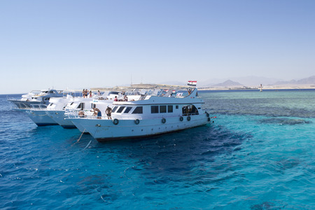 yachts moored near a reef for snorkeling red sea