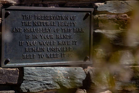Environment plaque on stone wall