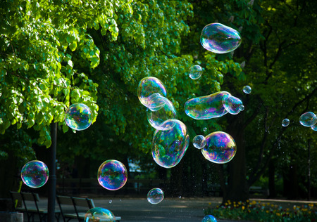 Rainbow bubbles from the bubble blower in the park