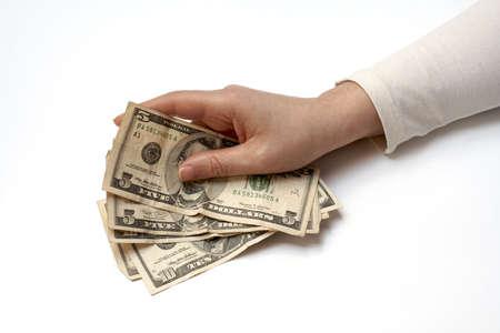 miser: Hand Holding Fan of American Money