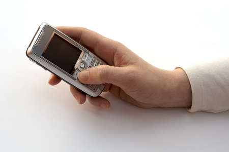 dialing: A hand dialing a cell phone Stock Photo