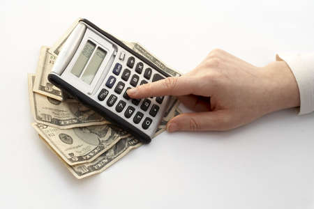 calculating over a fan of money photo