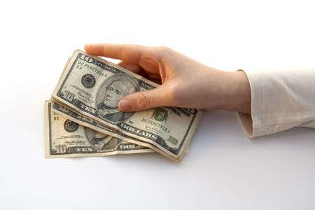 miser: Hand Holding a Fan of ten dollars