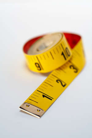 Yellow tape measure macro, isolated on white background Stock Photo - 355846