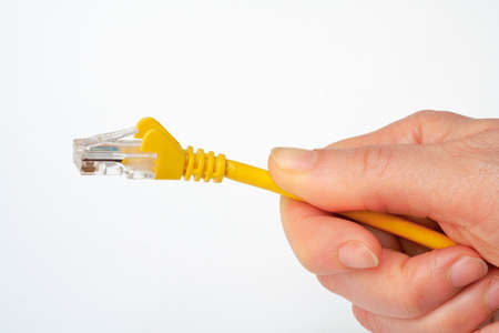 usb port: Hand holding network cable