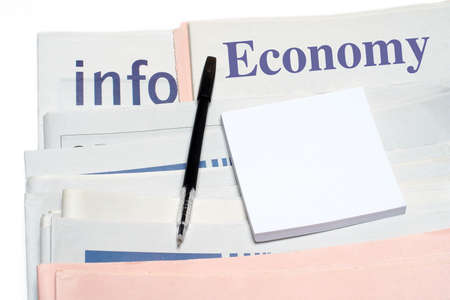 Note and pen, over stacked economy newspapers on white background Stock Photo - 417959
