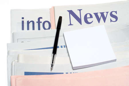 classifieds: Note and pen, over stacked newspapers on white background Stock Photo