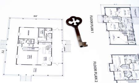 Key on home plan background photo