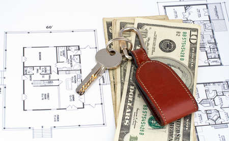 Key and money on home plan background photo
