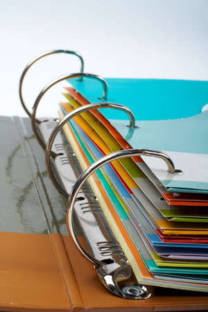 Binder closeup with files stacked (small DOF) photo