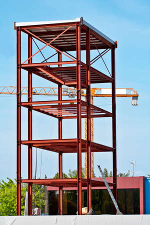 counterweight: Steel Structure and Construction crane set against a blue sky Stock Photo
