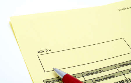 Close up Blank invoice with pen on white background photo