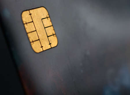 expires: Macro shot of credit card, view of the chip. Shallow depth of Field
