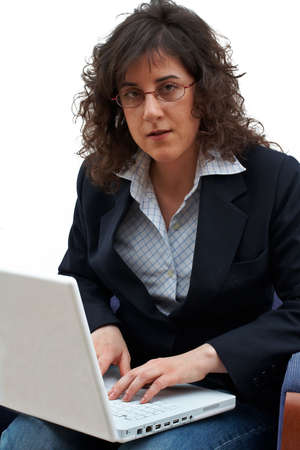 Business woman writing on laptop photo