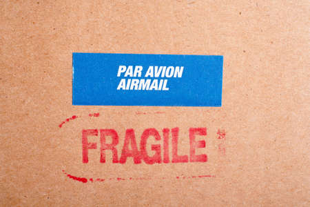 Fragile on cardboard box,  and par avion airmal sticker photo