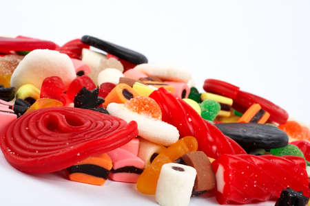 sickly: Detail of colorful sweets.  Macro shot on white background. Very shallow dof