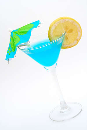 bartend: Blue cocktail with lemon and umbrella.  Macro shot on white background