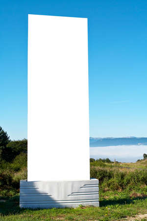 Blank billboard on blue sky in a mountainous area, just add your text photo