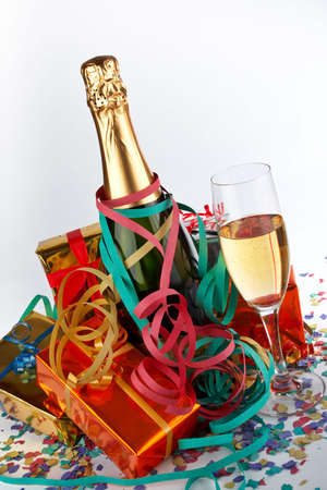 Assortment of gifts with champagne bottle and glass, ribbons and confetti Stock Photo - 500539
