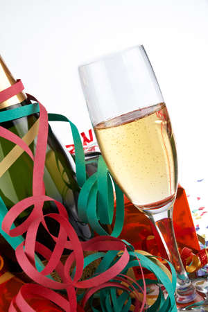 Detail of champagne glass and bottle, ribbons and confetti Stock Photo - 499686