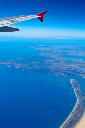 An aerial view of Portugal coast from an airplane photo